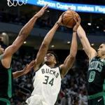 MILWAUKEE, WISCONSIN - APRIL 28: Giannis Antetokounmpo #34 of the Milwaukee Bucks attempts a shot while being guarded by Al Horford #42 and Jayson Tatum #0 of the Boston Celtics in the third quarter during Game One of Round Two of the 2019 NBA Playoffs at the Fiserv Forum on April 28, 2019 in Milwaukee, Wisconsin. NOTE TO USER: User expressly acknowledges and agrees that, by downloading and or using this photograph, User is consenting to the terms and conditions of the Getty Images License Agreement. (Photo by Dylan Buell/Getty Images)