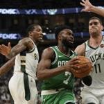 Boston Celtics' Jaylen Brown drives past Milwaukee Bucks' Eric Bledsoe and Brook Lopez (11) during the second half of Game 2 of a second round NBA basketball playoff series Tuesday, April 30, 2019, in Milwaukee. The Bucks won 123-102 to tie the series at 1-1. (AP Photo/Morry Gash)