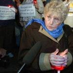 Eva Kor, at a candlelight vigil in 2003, after an arsonist firebombed her Holocaust museum.