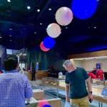 Customers shop as giant, color-changing orbs synchronized to music float overhead at Planet 13 in Las Vegas
