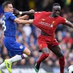 LONDON, ENGLAND - SEPTEMBER 22: Sadio Mane of Liverpool is tackled by Cesar Azpilicueta of Chelsea during the Premier League match between Chelsea FC and Liverpool FC at Stamford Bridge on September 22, 2019 in London, United Kingdom. (Photo by Laurence Griffiths/Getty Images)