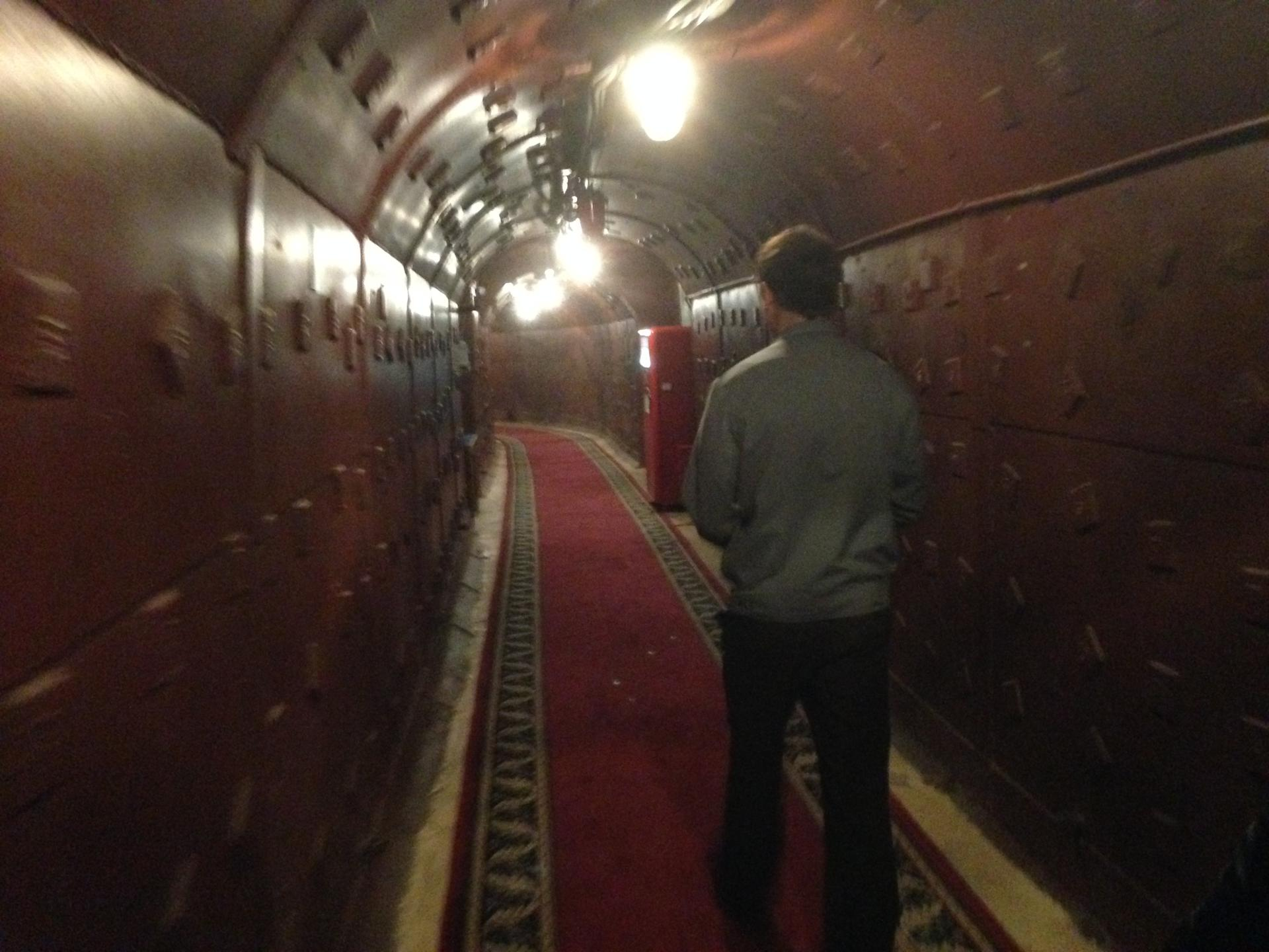 Tour guide Fyodor Belousov moved through a corridor in the Cold War museum at Bunker-42 on Taganka, located in a secret Cold War-era underground bunker that was designed to withstand a nuclear attack on Moscow.