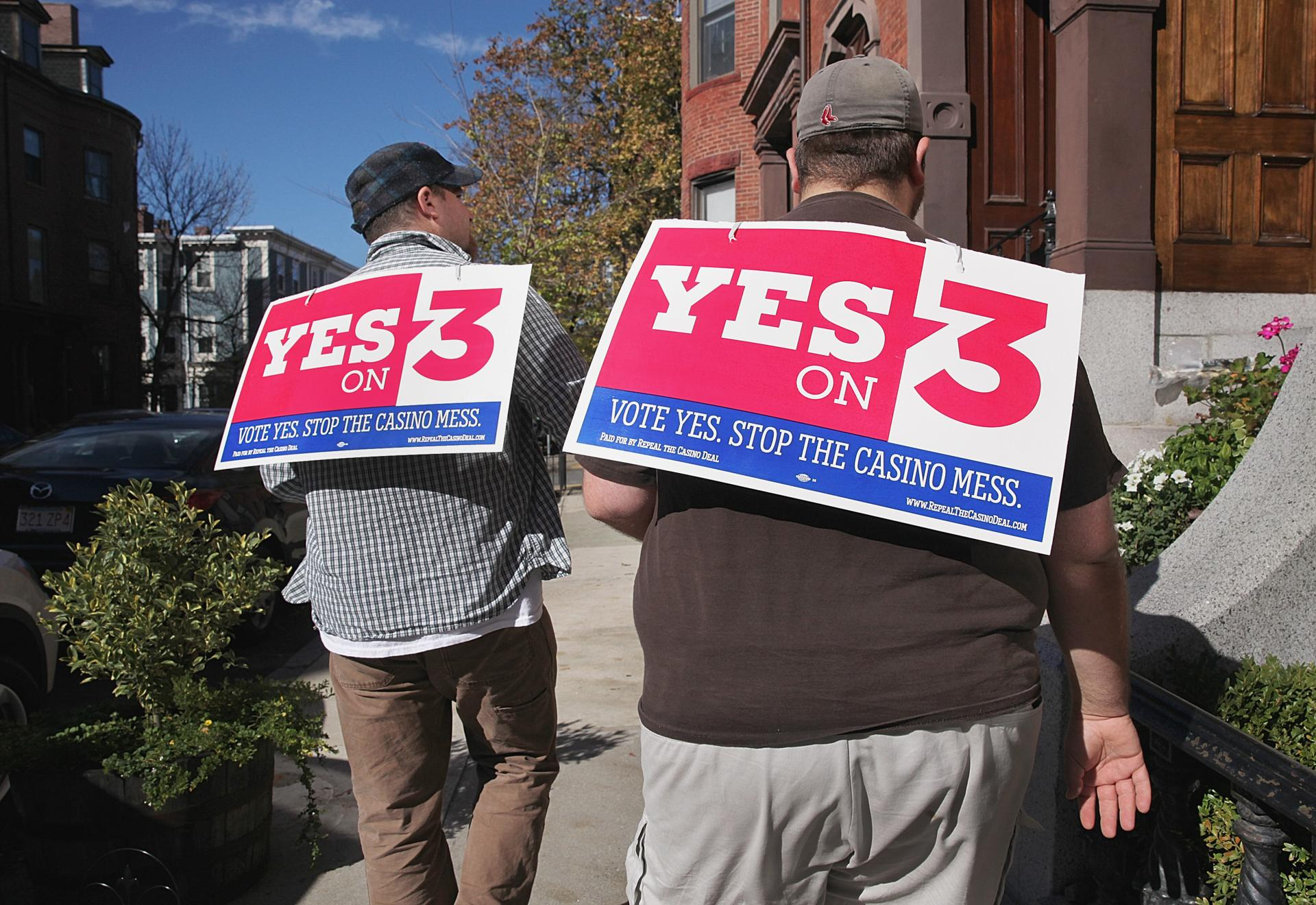 Boston, MA 102514 Anti casino volunteers John Rogers (cq), left, of East Boston and Joseph Catricala (cq), rt, of Revere canvassed potential voters on High Street in Charlestown, Saturday, October 25 2014. (Wendy Maeda/Globe Staff) section: Metro slug: 29casinogroundgame reporter: Laura Crimaldi