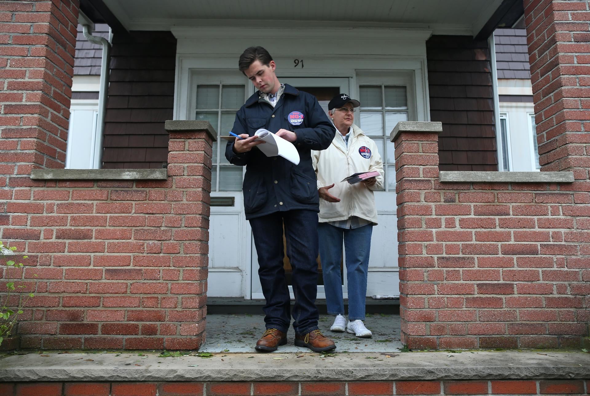 Ryan Holmes and LouAnne Zawodny canvassed in Chelsea to encourage voters to oppose the referendum.