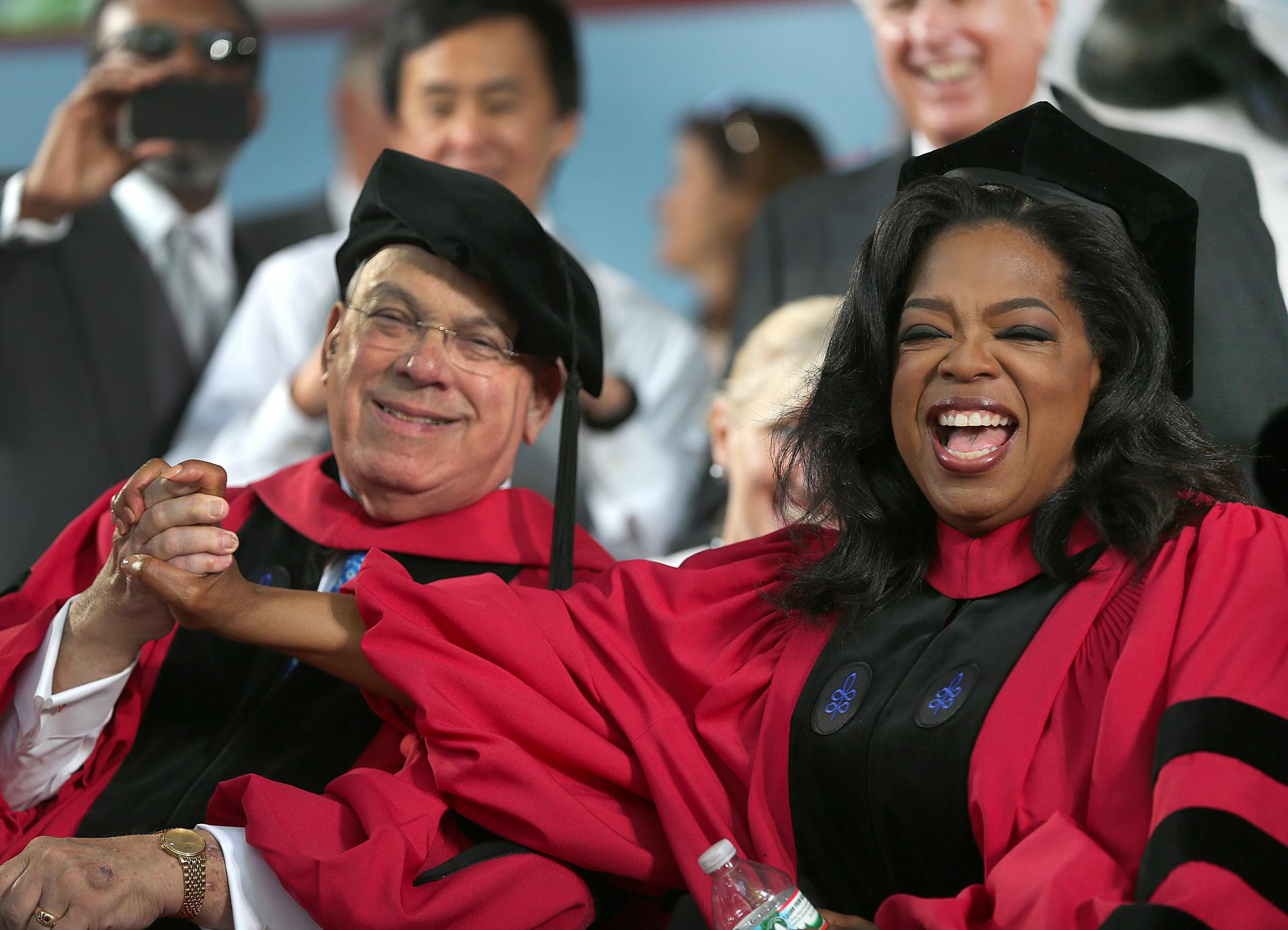 Thomas Menino sat with Oprah Winfrey at Harvard's graduation ceremony, where both recevied honorary doctorates.