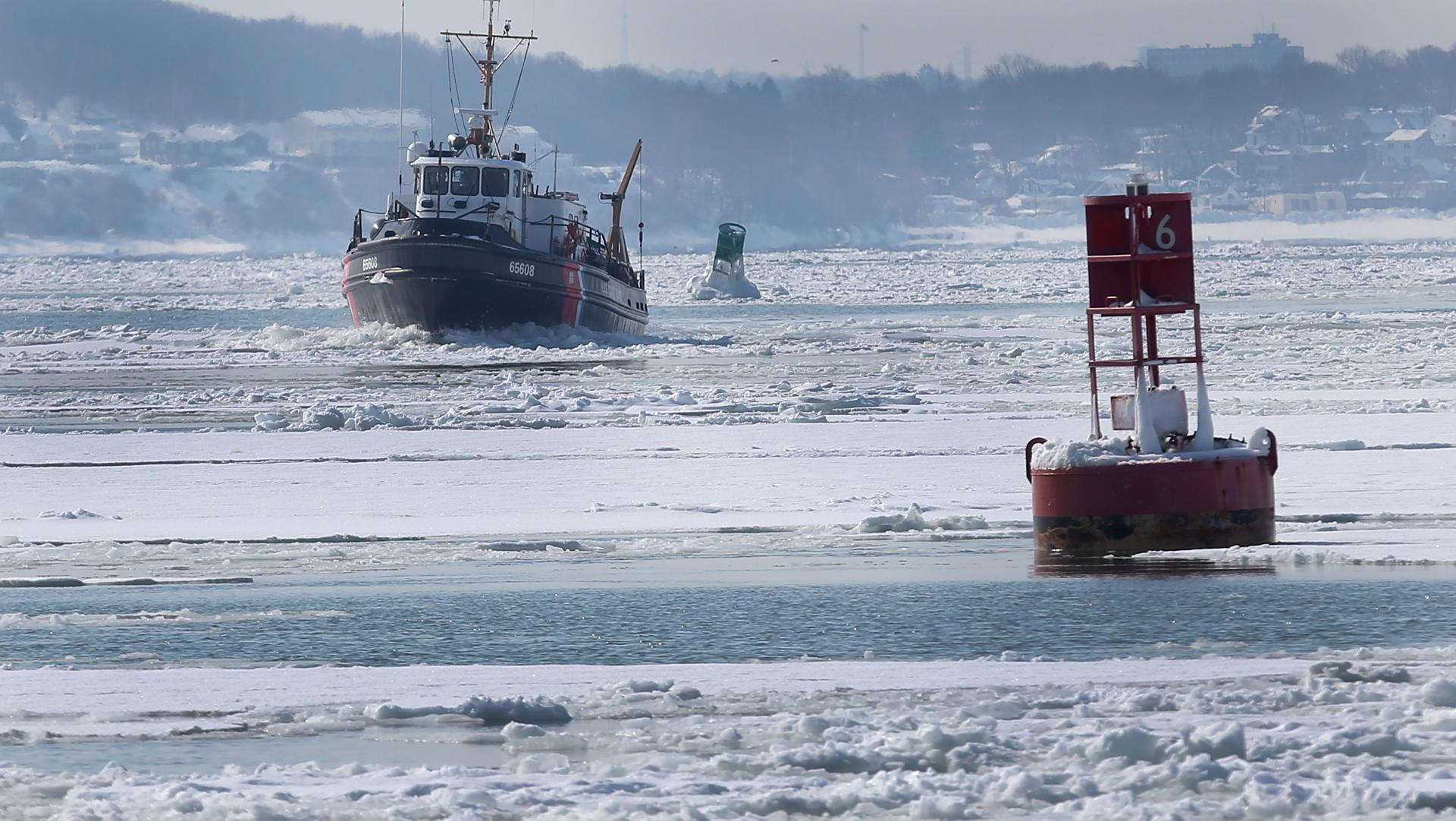 A Coast Guard vessel broke up ice in Hull Bay Thursday, an effort that has criss-crossed between there and Boston Harbor for months.