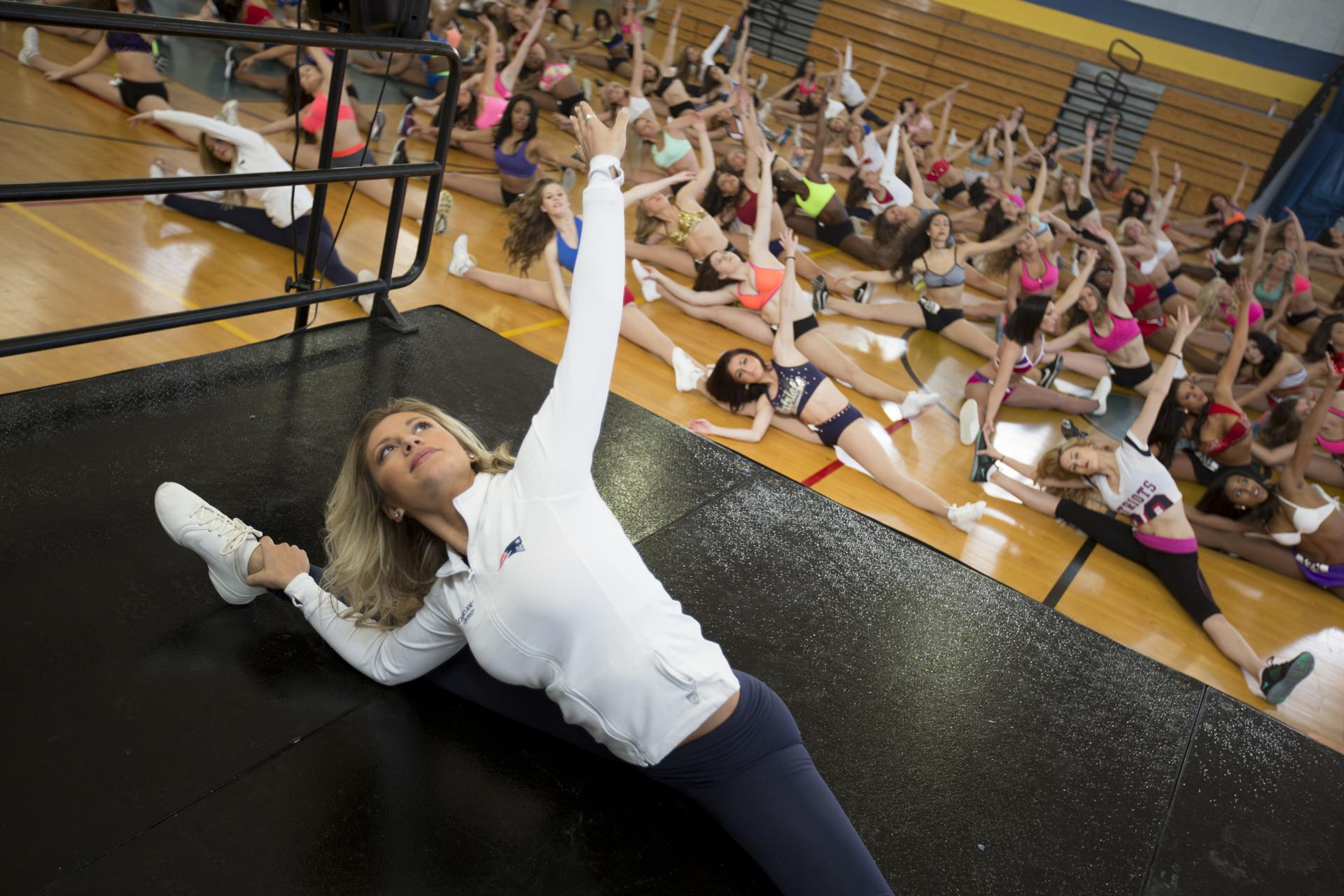 Patriots Cheerleaders captain Alex Stavropoulos of Needham led the prospective cheerleaders in stretches.