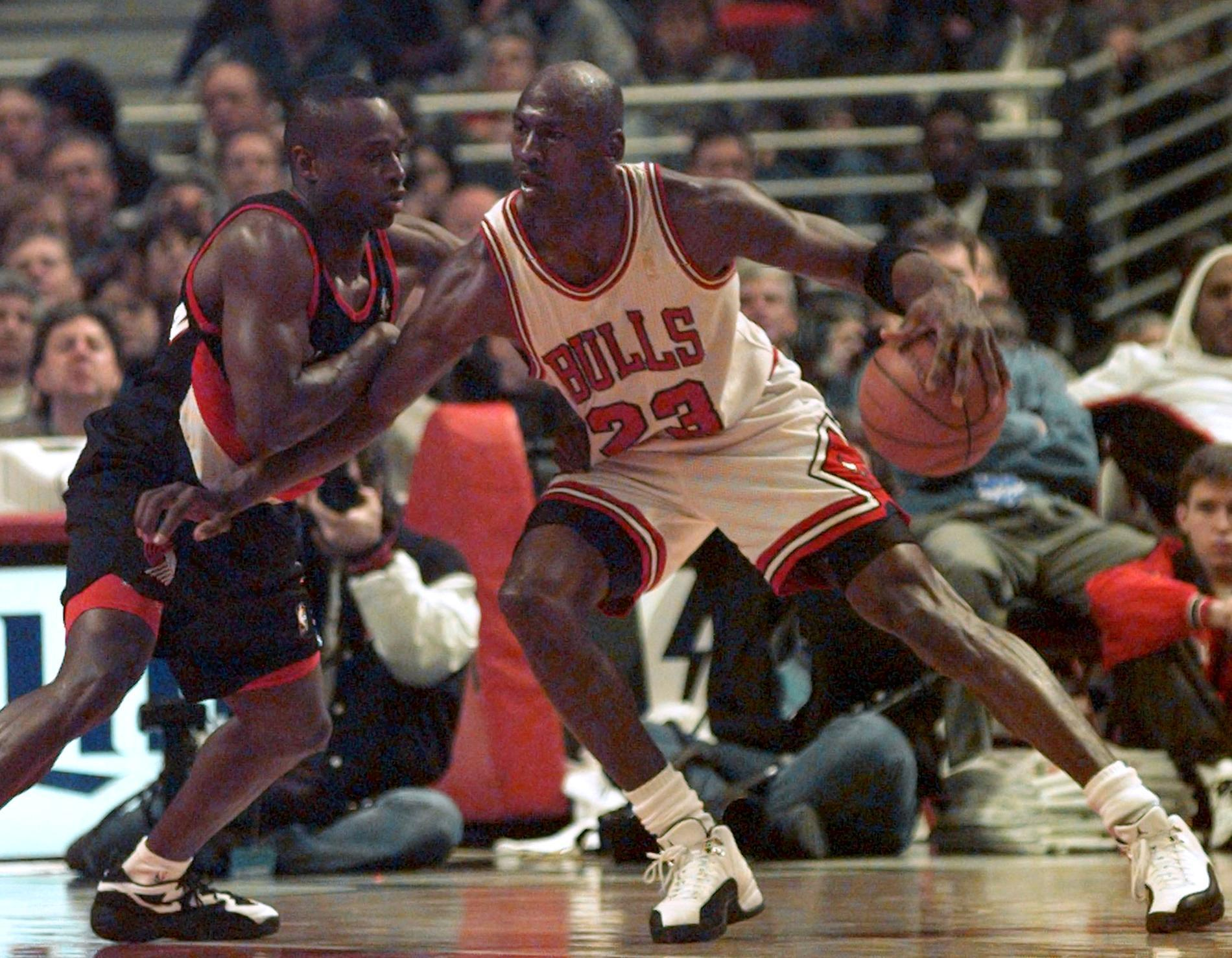 Chicago Bulls' Michael Jordan (23) slams the ball through the hoop over Miami Heat's Keith Askins (2) during first quarter action in Miami Friday Feb. 23, 1996. (AP Photo/Hans Deryk)