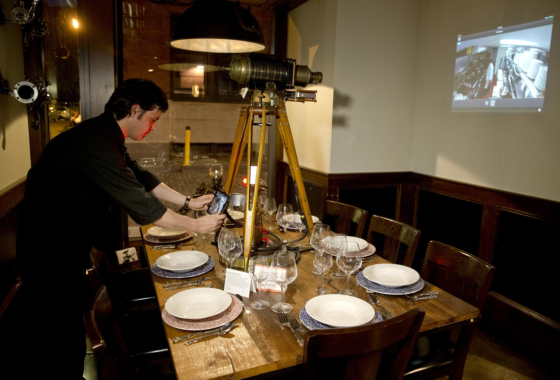 The steampunk table at Mast' features a Wi-Fi camera that shows the cooks preparing dishes.
