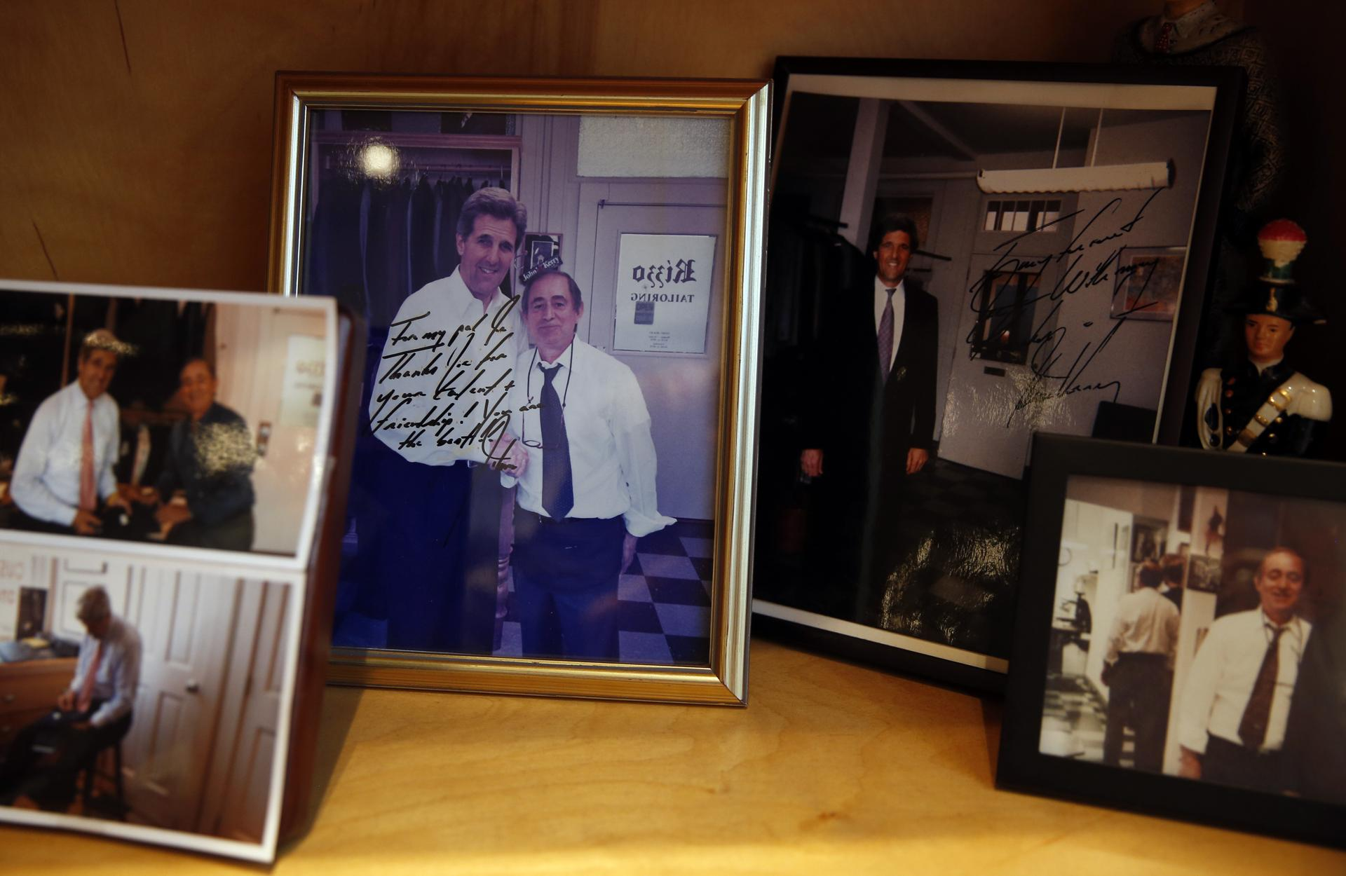 Photographs of tailor Joe Calautti with Secretary of State John Kerry are seen inside of Rizzo Tailors.