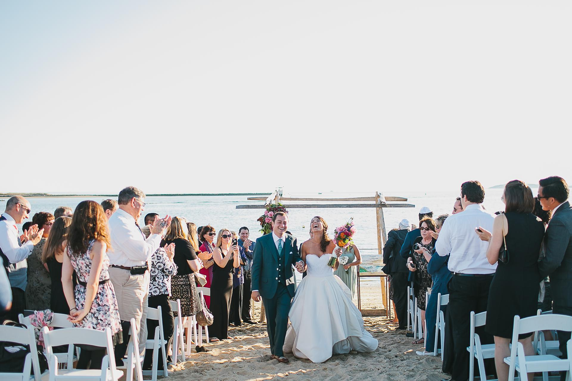 In their shoe-optional beach ceremony, the couple exchanged vows under a chuppah made of old fence posts. Wellfleet.