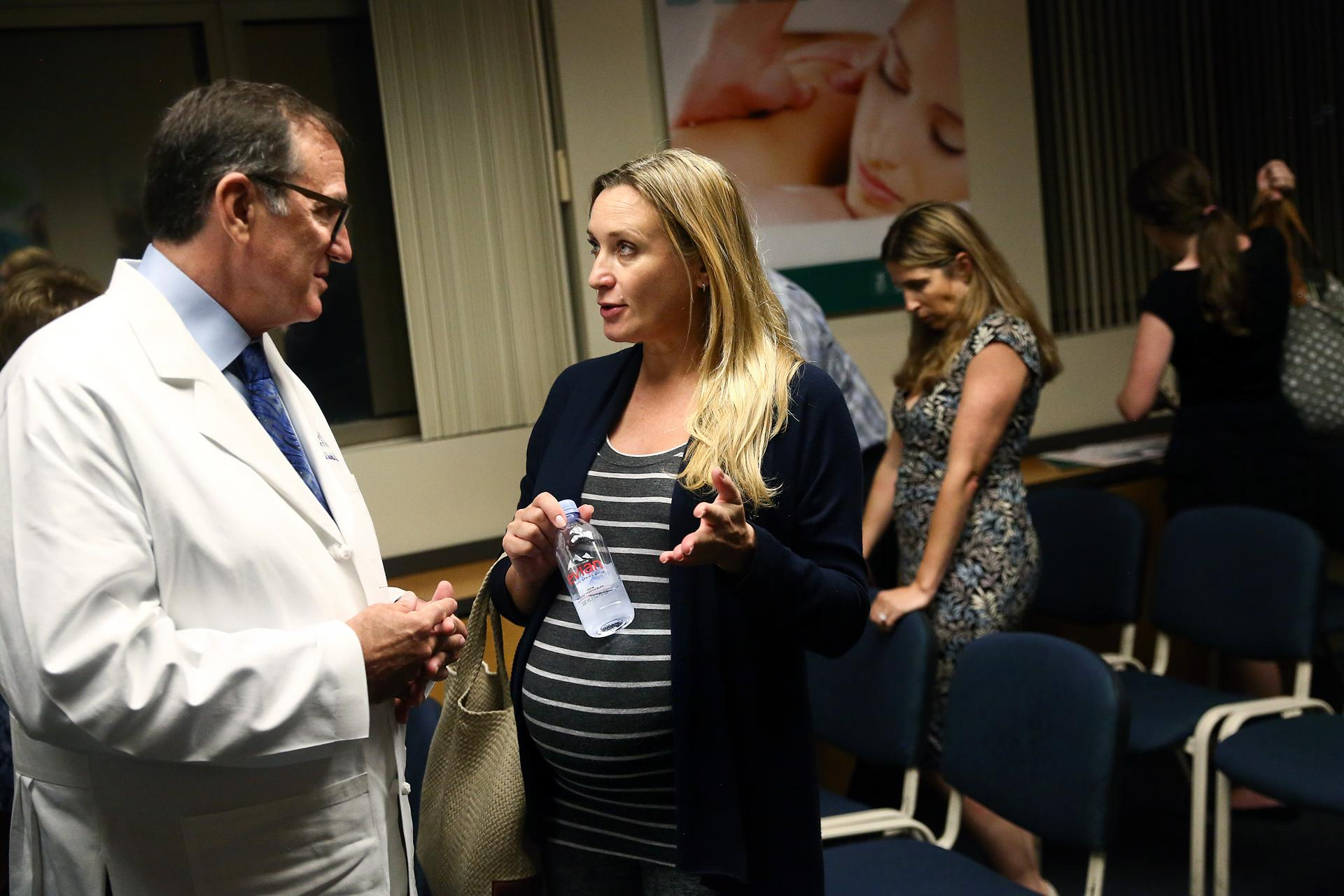 Dr. Michael Jacobs talked with Olena Shcheolrina after a forum about Zika and pregnancy at a Florida hospital.