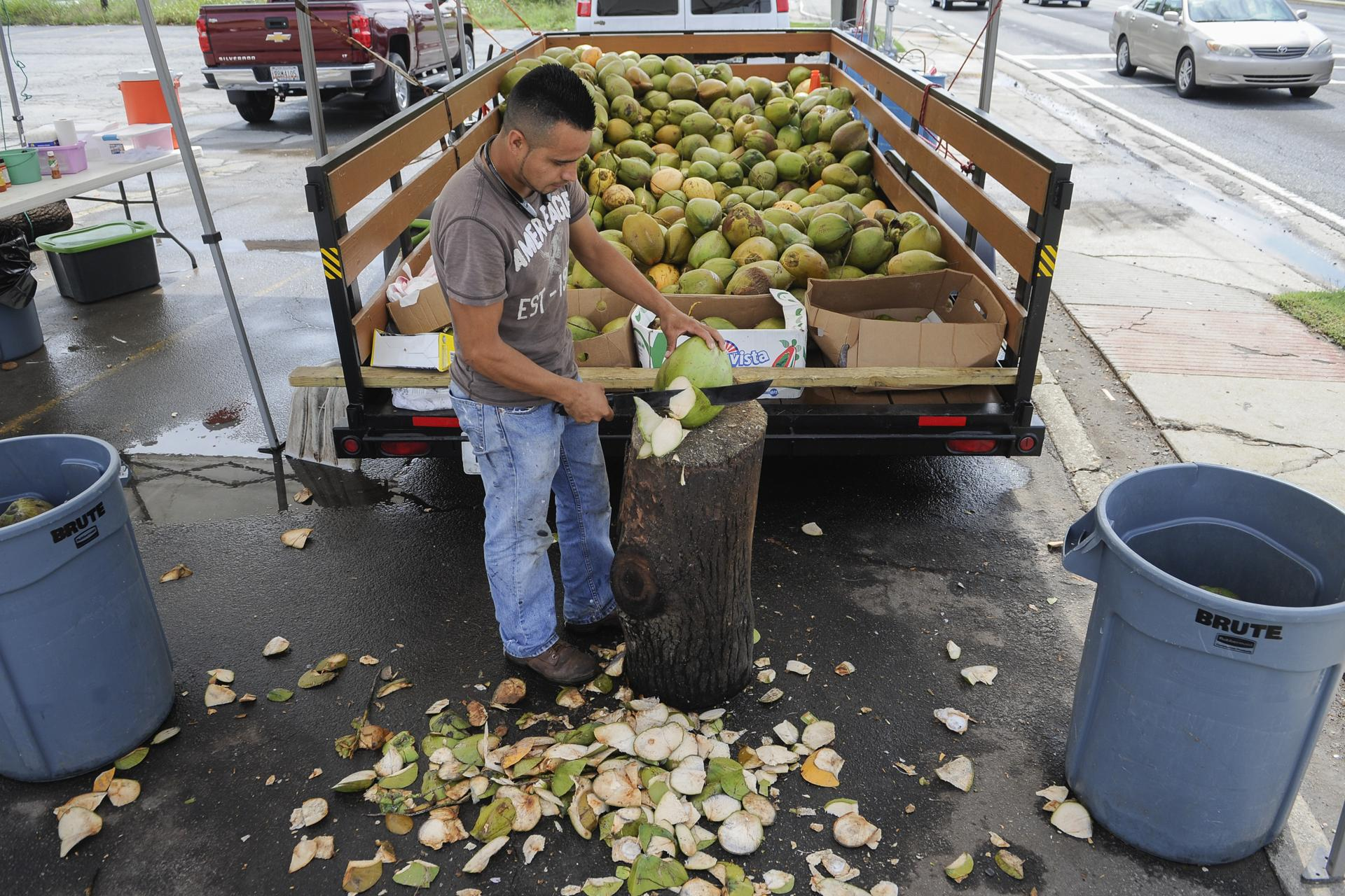 Odilon Rodriguez, of Mexico, is pictured late last month at the coconut stand at which he works alongside Buford Highway, in the vacant parking lot of a one time Dairy Queen, turned cafe, and which is now torn down.