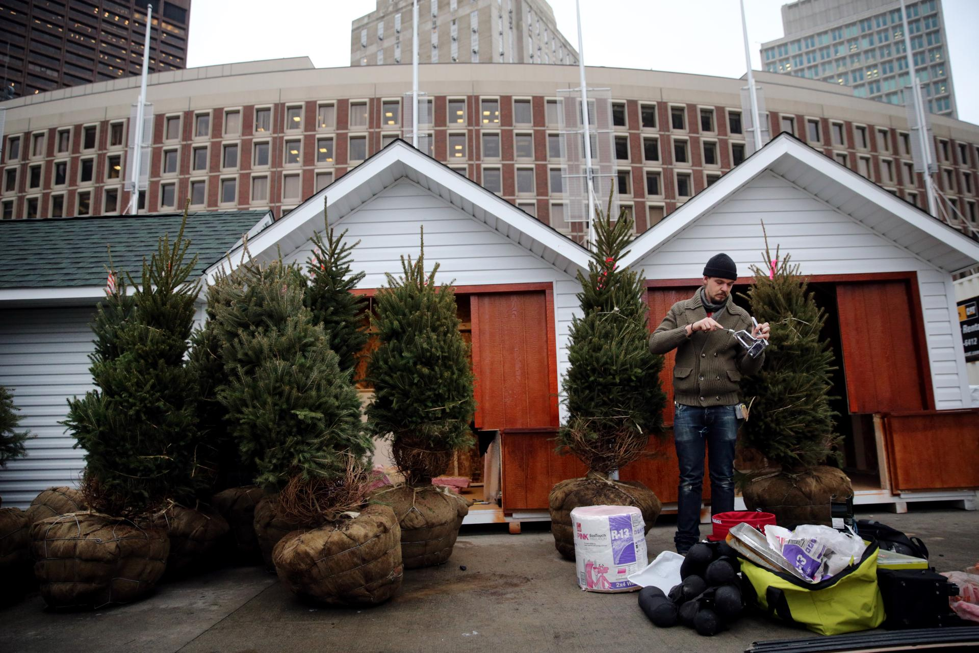 Sam Underkofler of Brothers Artisan Oil was surrounded by Christmas trees while he winterized the company's chalet.