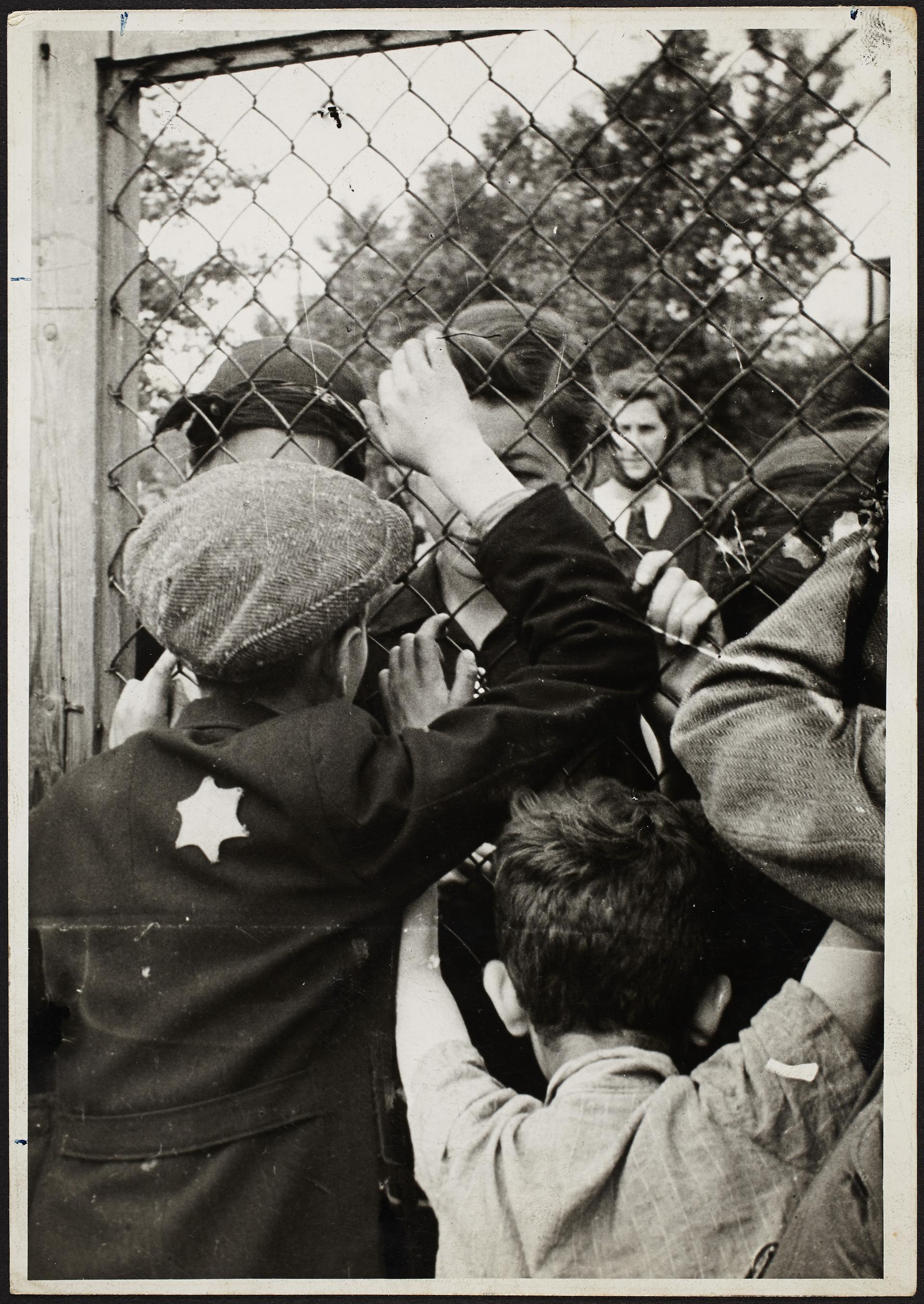 Ross's photo of children talking through the fence of a prison in the Lodz Ghetto prior to deportation, from the MFA exhibit.