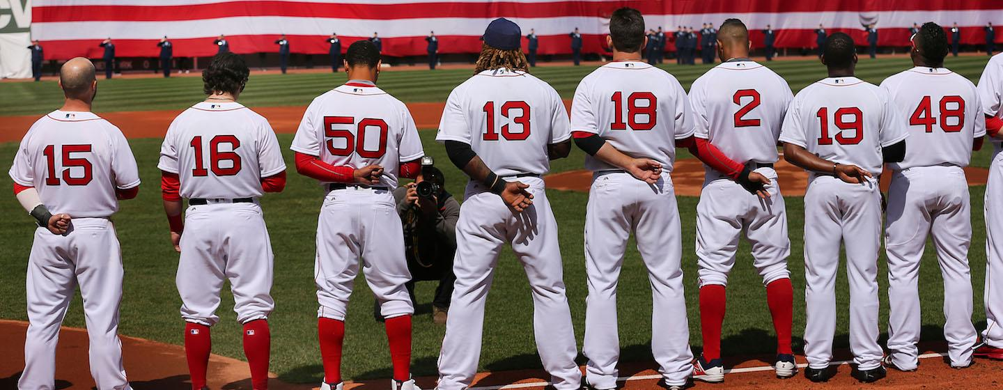 On Opening Day at Fenway Park, Red Sox players lined up during the national anthem before beating the Pirates, 5-3.