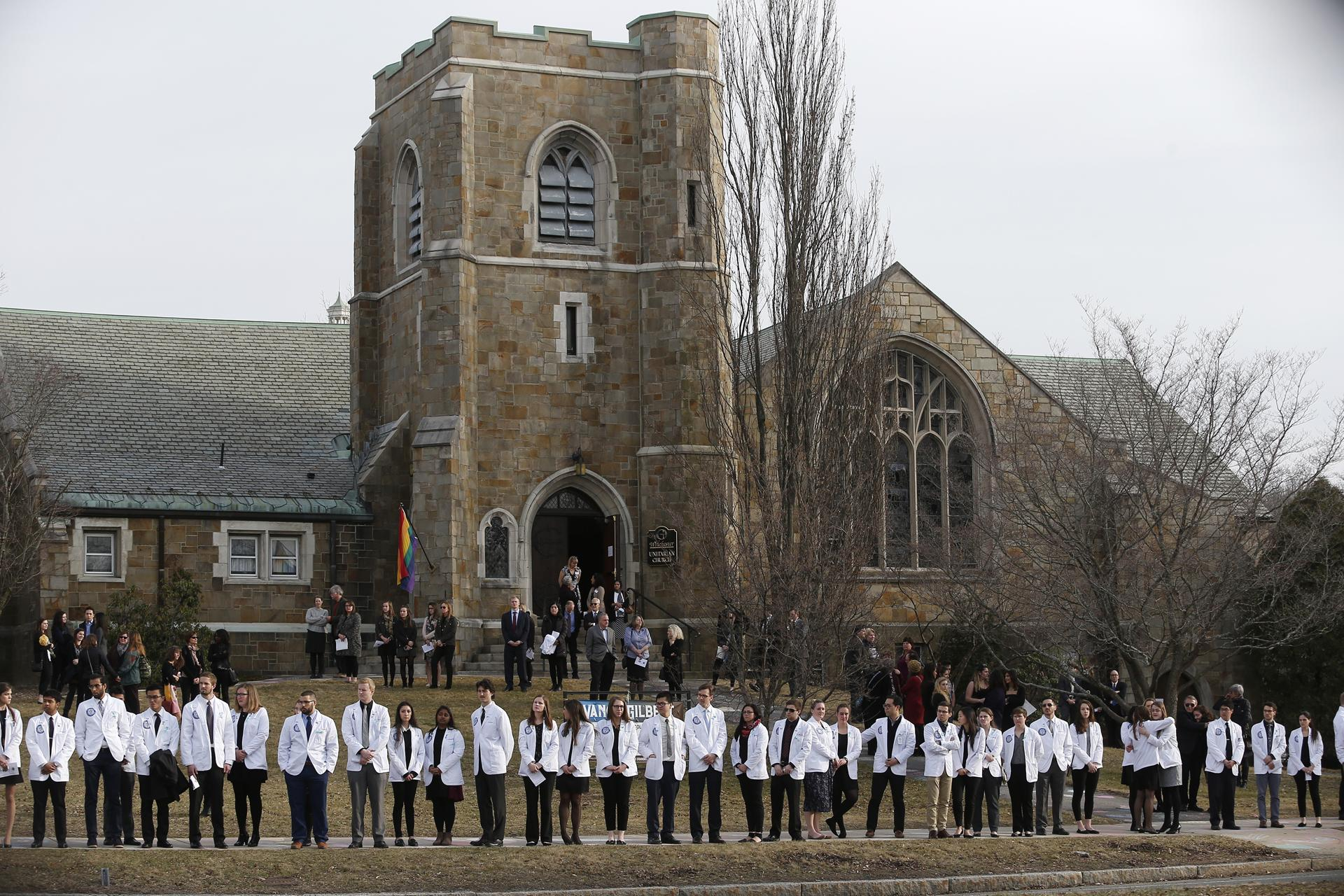 Students from the New England College of Osteopathic Medicine lined the sidewalk outside the Winchester Unitarian Society Thursday.