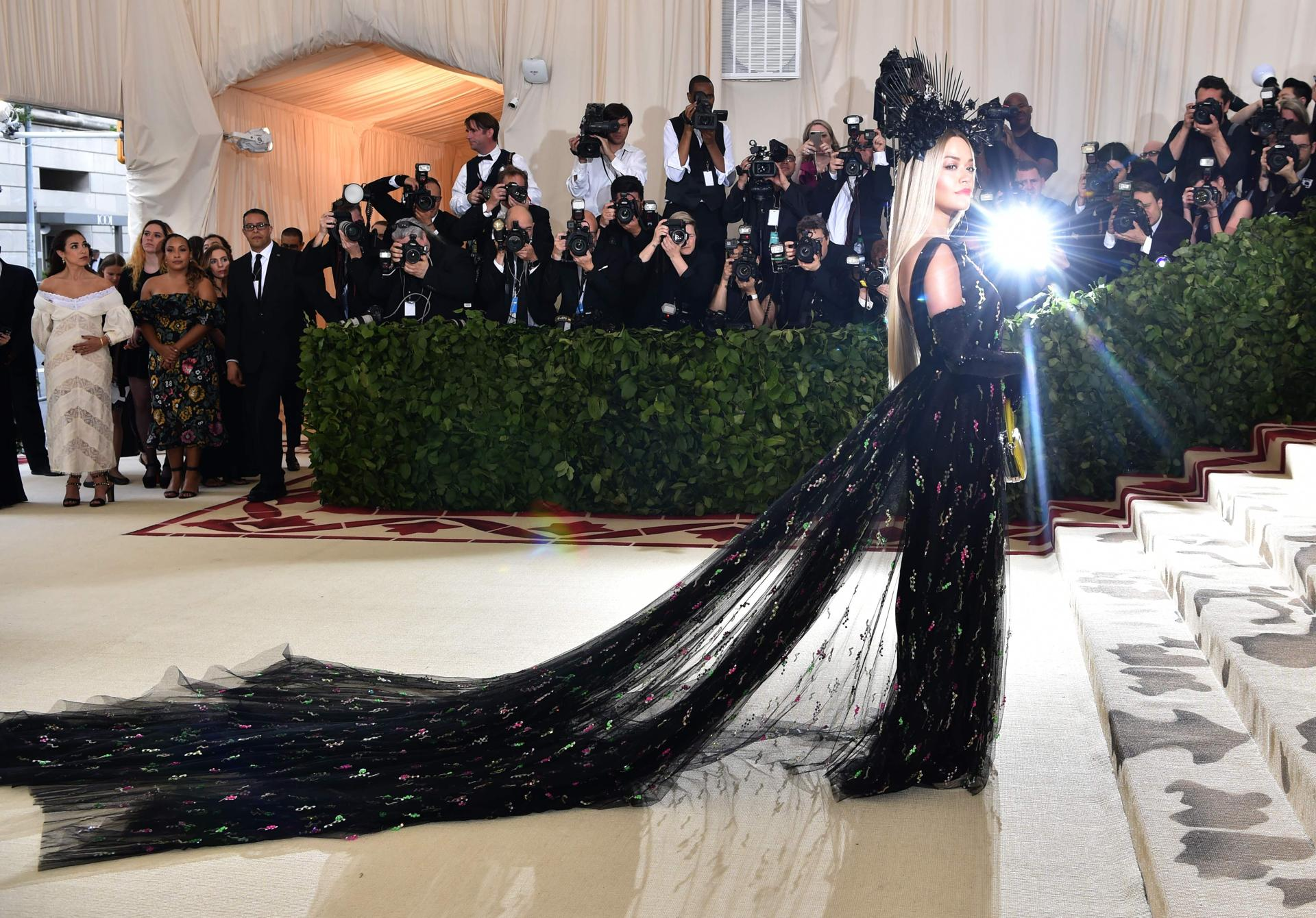 Rita Ora arrives for the 2018 Met Gala on May 7, 2018, at the Metropolitan Museum of Art in New York. The Gala raises money for the Metropolitan Museum of Artââ¬â¢s Costume Institute. The Gala's 2018 theme is ââ¬ÅHeavenly Bodies: Fashion and the Catholic Imagination.ââ¬ï¿½ / AFP PHOTO / Hector RETAMALHECTOR RETAMAL/AFP/Getty Images