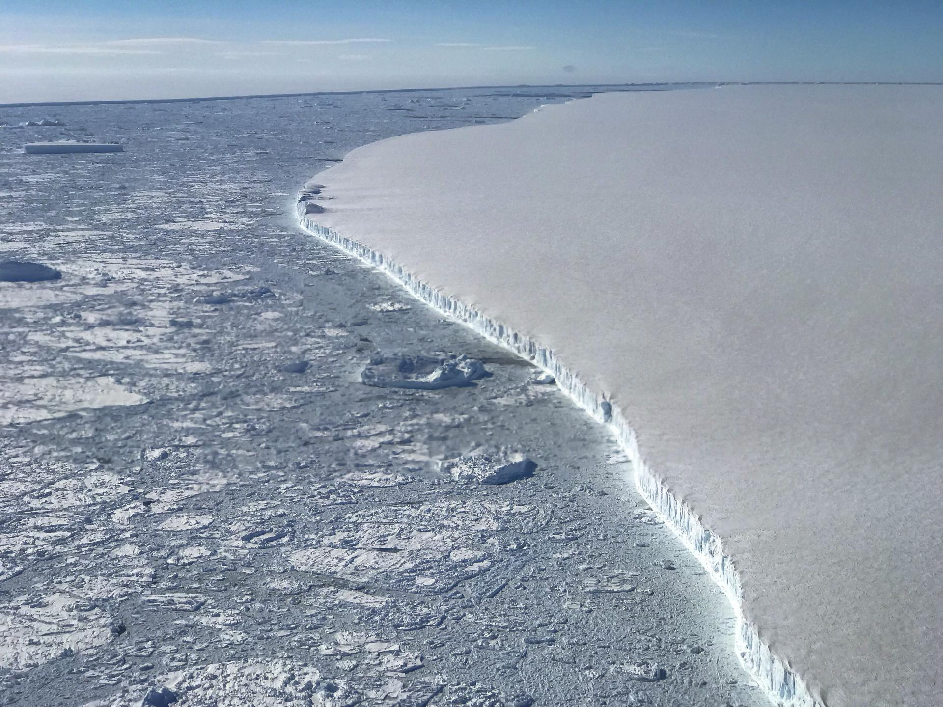 In a NASA photo, the western edge of one of the largest icebergs ever recorded, which broke away from the Antarctic Peninsula last year. The continent's rate of ice loss is speeding up, which is contributing even more to rising sea levels. according to a study published Wednesday in the journal Nature. (Nathan Kurtz/NASA via The New York Times) — FOR EDITORIAL USE ONLY