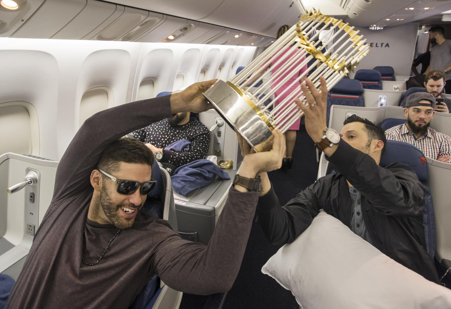 J.D. Martinez handed the World Series trophy off to Joe Kelly on Monday's flight home from Los Angeles.
