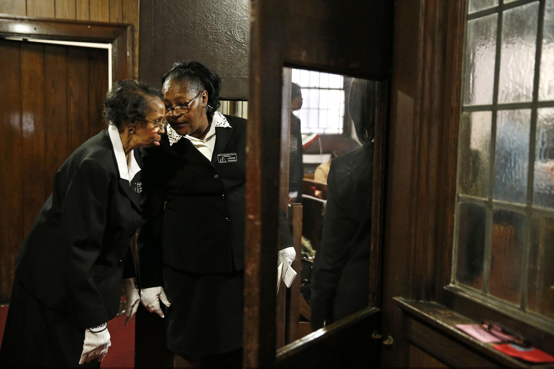 Ushers whispered to each other at the Eliot Congregational Church of Roxbury.