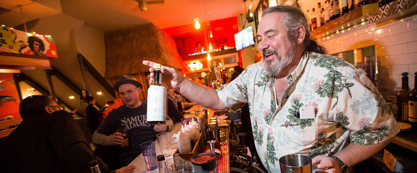 Joe McGuirk works behind the bar at Highland Fried in Cambridge.