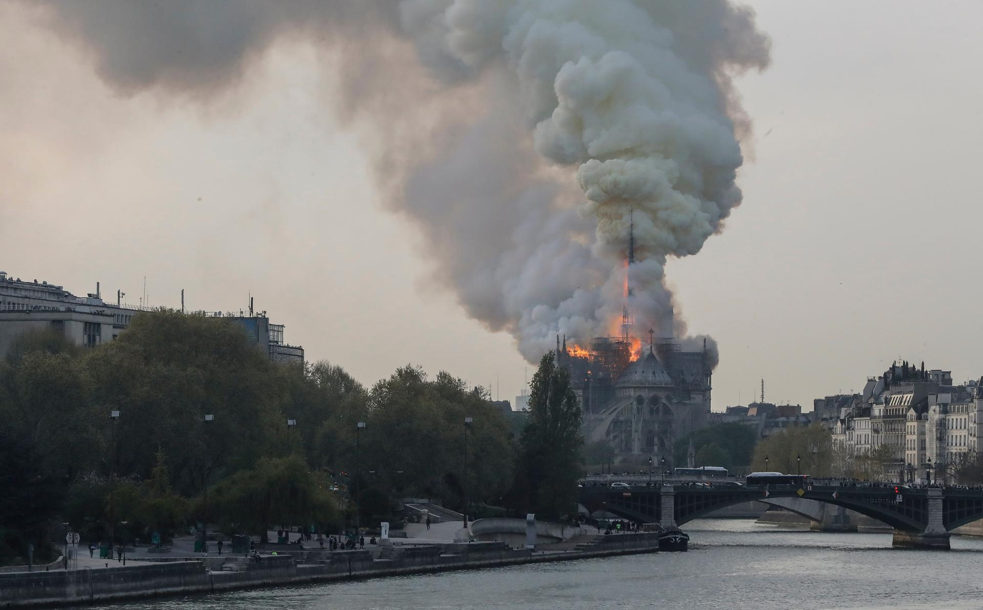 TOPSHOT - Smokes ascends as flames rise during a fire at the landmark Notre Dame Cathedral in central Paris on April 15, 2019 afternoon, potentially involving renovation works being carried out at the site, the fire service said. (Photo by FRANCOIS GUILLOT / AFP)FRANCOIS GUILLOT/AFP/Getty Images