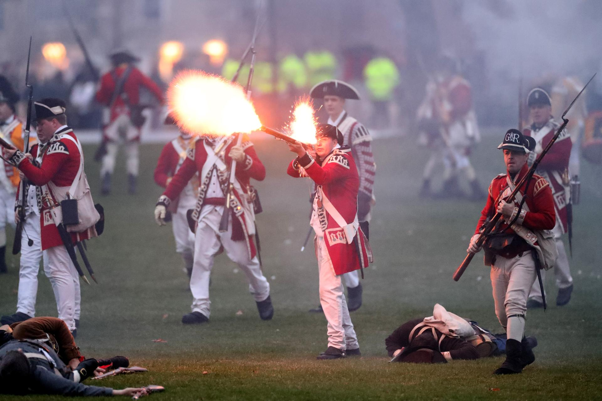 APRIL 15, 2019 --LEXINGTON, MA - Lexington Minute Men lie dead and wounded on ground as Her Majesty's Army fires their mustkets as re-enactors depict the skirmish that took place on Lexington common early on the morning of April 19, 1775. (Joanne Rathe/ Globe Staff)