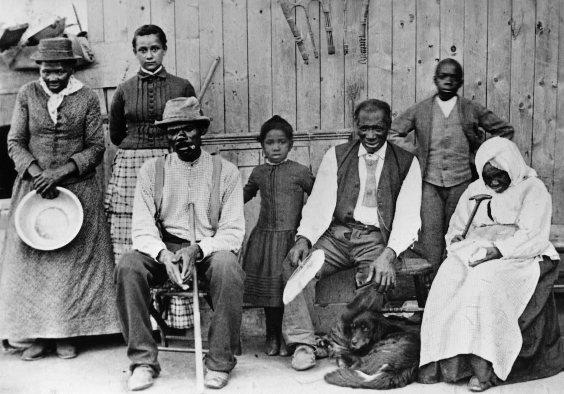 Harriet Tubman (left) posed for a photograph with a group of slaves she helped escape. Climate change is imperiling a number of important African American historical sites.