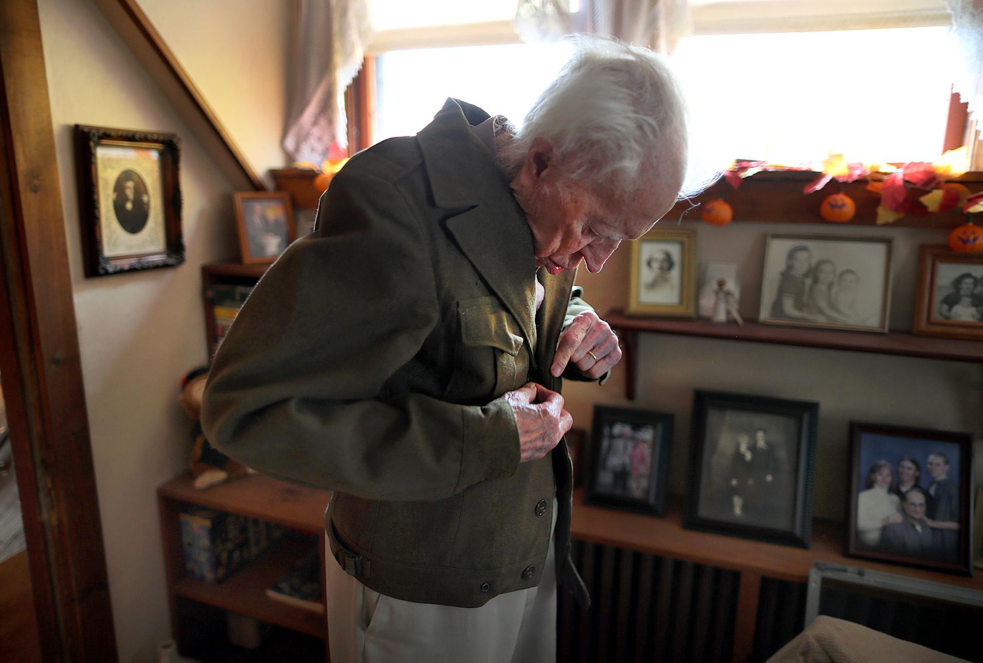 Russell Pittsley last month buttoned the Army jacket that he wore during World War II, when he served in the infantry.