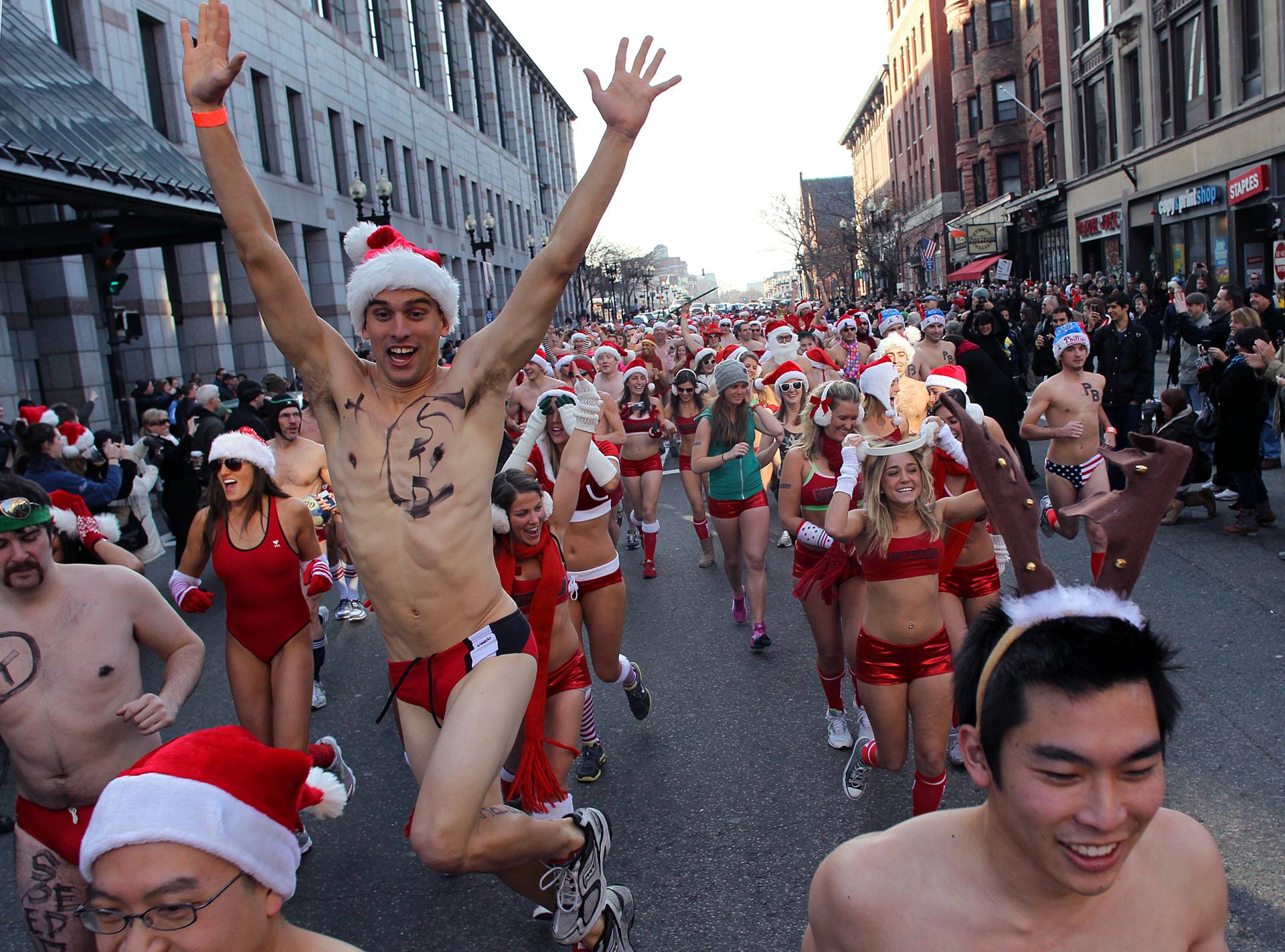 Boston-12/11/2010- During the annual Santa Speedo Run which started at the Lir Irish Pub & Restaurant on Boylston Street, a runner jumps in the air at the start. Boston Globe staff photo by John Tlumacki (metro) Library Tag 12122010 Metro