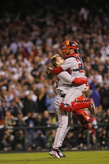 Jason Varitek leaps into the arms of Jonathan Papelbon as they celebrate the Red Sox' second World Series title in four years.