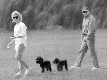 Whitey Bulger and his girlfriend, Catherine Greig, walk together with her two poodles in 1988.