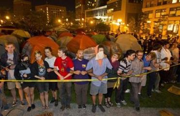 Occupy Boston protesters linked arms before getting arrested for tresspassing and unlawful assembly by the Boston Police at the Rose Fitzgerald Kennedy Parkway eariler this morning.