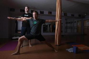 Broga co-founders Robert Sidoti (front) and Adam O'Neill were once reluctant to commit to yoga.