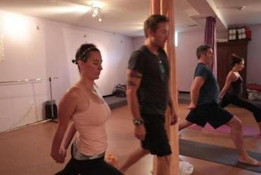 From left, Bethany Vasecka, Broga cofounders Robert Sedoti and Adam O'Neill, and Anya Woods took part in a Broga class at the Armory in Somerville.