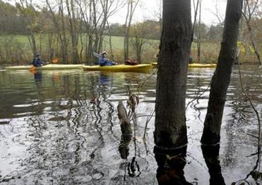 Members of the Endicott College Outdoor Adventure Club set off on a trip on the Ipswich River