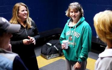 Janet Casselman, Missy Pickett, Amanda Anderson, and Linda Thurlow discussed candidate Mitt Romney after hockey practice at the Rinks at Exeter in Exeter, N.H.