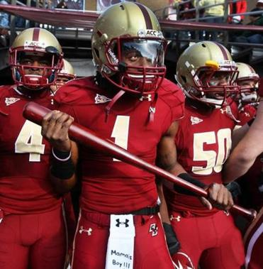 Boston College wide receiver Colin Larmond Jr. carries a baseball bat onto the field during pregame introductions at Alumni Stadium.