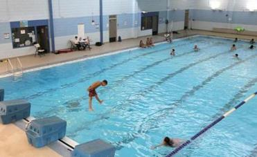 Holland school students (above) can use an indoor pool and enjoy other advantages.