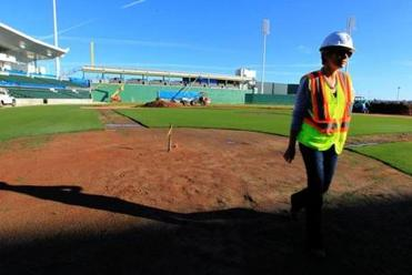 Katie Haas, Red Sox director of Florida business operations, examined the home plate area.