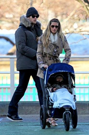 Tom Brady and Gisele Bundchen take their son Benjamin out for a stroll in Boston recently.