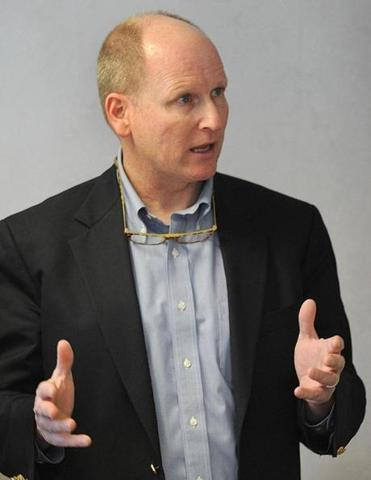 State Representative Dan Winslow talked with bank officials last March during a meeting at the Wrentham Co-operative Bank.