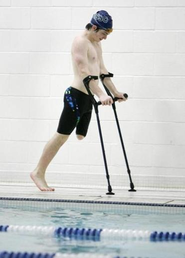 Brendan Driscoll, an 8th grader at Manchester-Essex High School who is a member of the swim team despite the fact that he is an above-the-knee amputee at practice. Jon Mahoney/For the Boston Globe
