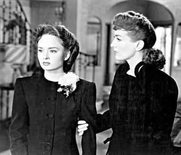 "FOR USE OTHER THAN FOR THIS SHOW/FILM PLEASE CONTACT NETWORK OR FILM COMPANY. TELEVISION BOOK 6/24/01. MOVIES: Ann Blyth, left, and Joan Crawford in the film 'Mildred Pierce' (1945). PHOTO CREDIT -- The Museum of Modern Art Published in NYT 06/24/01 - TELEVISION Section Published Caption: Ann Blyth, left, and Joan Crawford in ""Mildred Pierce"" (1945). (The Museum of Modern Art) 22separation"