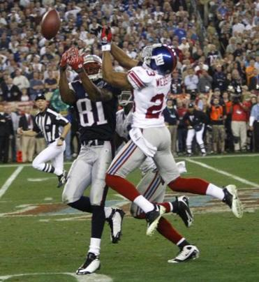 Randy Moss was held to five catches, one for a touchdown, by the Giants.