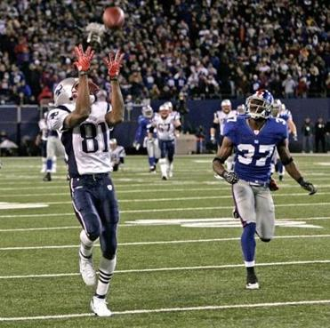This catch gave Randy Moss the single-season record for touchdown receptions with 23.