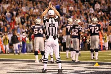 Referee John Parry flagged Tom Brady for intentional  grounding in the end zone.