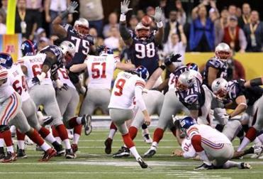 INDIANAPOLIS, IN - FEBRUARY 05: Kicker Lawrence Tynes #9 of the New York Giants kicks a 38 Yard field goal in the third quarter against the New England Patriots during Super Bowl XLVI at Lucas Oil Stadium on February 5, 2012 in Indianapolis, Indiana. (Photo by Andy Lyons/Getty Images)