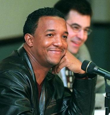 Pedro Martinez, left, and general manager Dan Duquette were happy to talk about another Cy Young award.